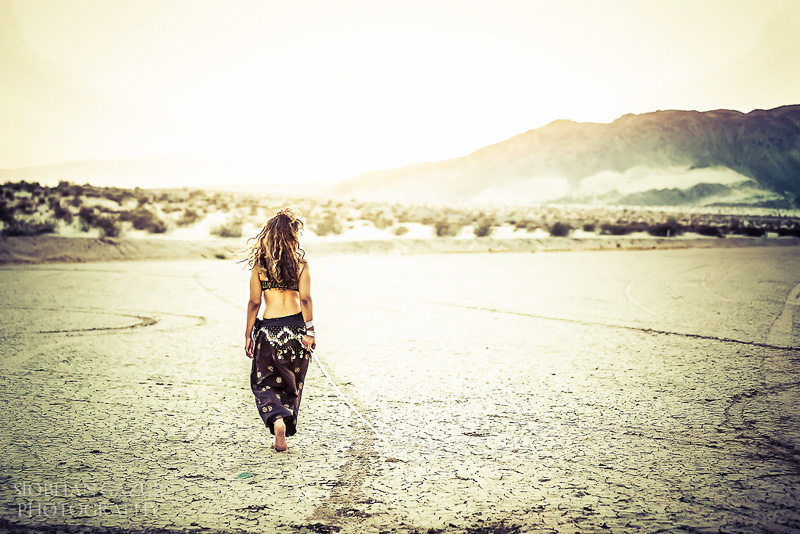 San Diego Fashion Photographer - Portrait of a Woman Musician Walking in California Desert.