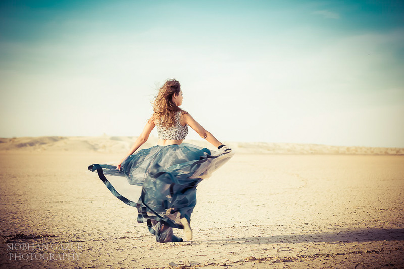 San Diego Fashion Photographer - Portrait of a Woman Musician Dancing in California Desert