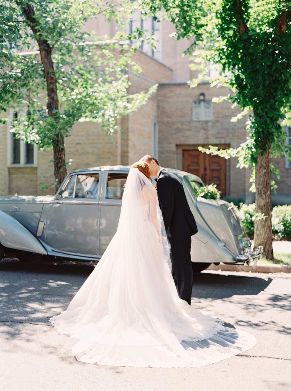 Calgary Wedding Photographer | Canmore Wedding Photographers | Banff Wedding Photography | Fairmont Palliser | Calgary Church | Blue bridesmaids | Vintage Car