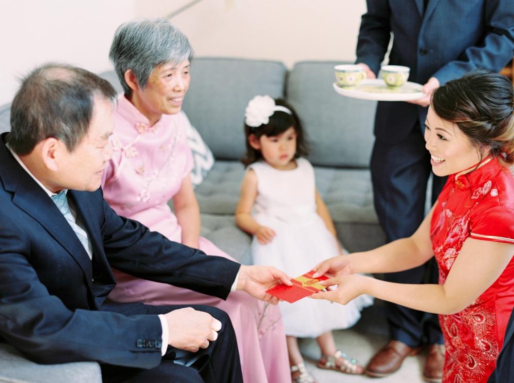 Asian tea ceremony wedding celebration | Justine milton fine art wedding photographers | calgary wedding at the lake house