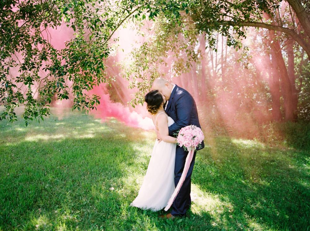 Bride and groom portraits with smoke bombs | BHLDN wedding dress | Justine milton fine art wedding photographers | calgary wedding at the lake house