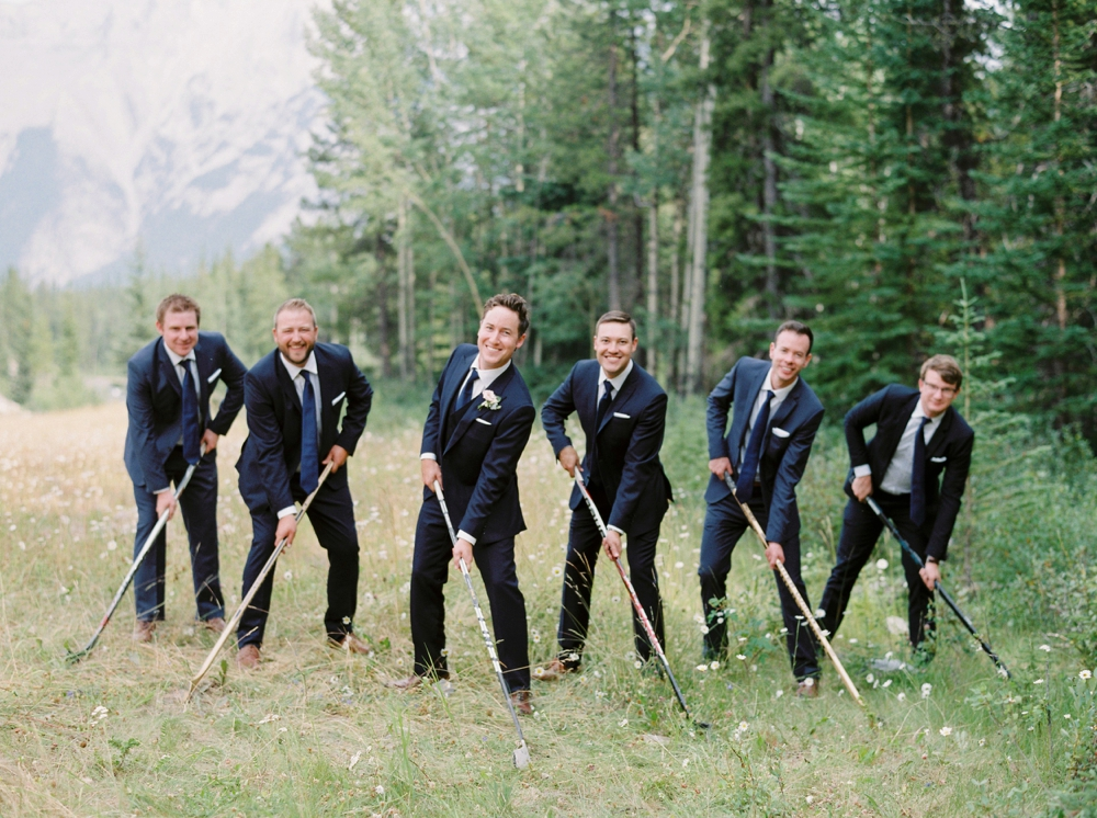 groomsmen in navy suits hockey photo | Banff springs wedding photographers | fairmont banff rocky mountain wedding | Justine Milton fine art film Photography