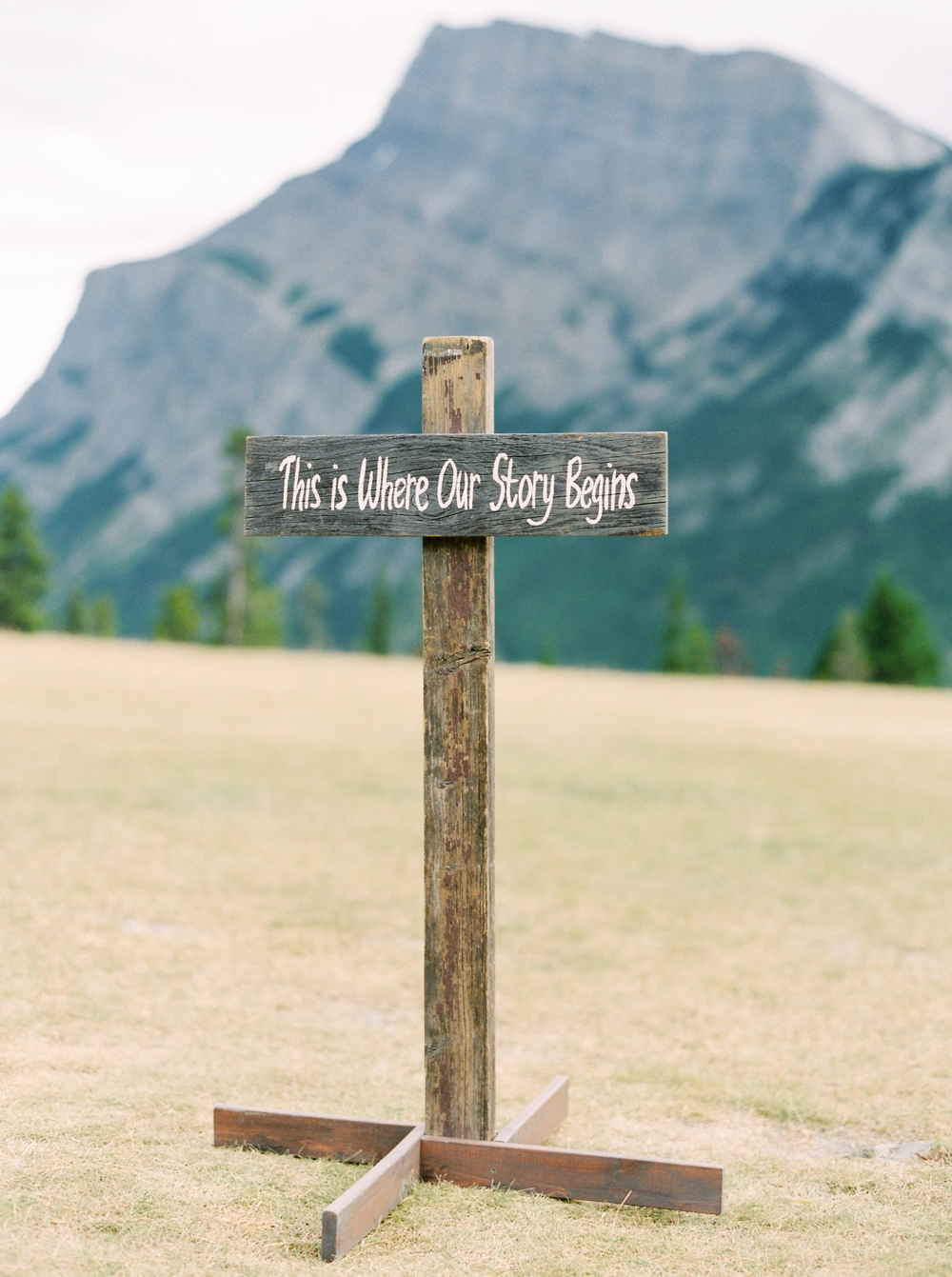 Banff Wedding Photographers | wedding ceremony decor wooden sign | Justine Milton fine art film photographers