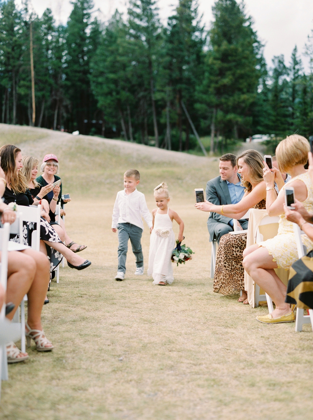 Banff Wedding Photographers | wedding ceremony tunnel mountain | flower girl and ring bearer | Justine Milton fine art film photographers