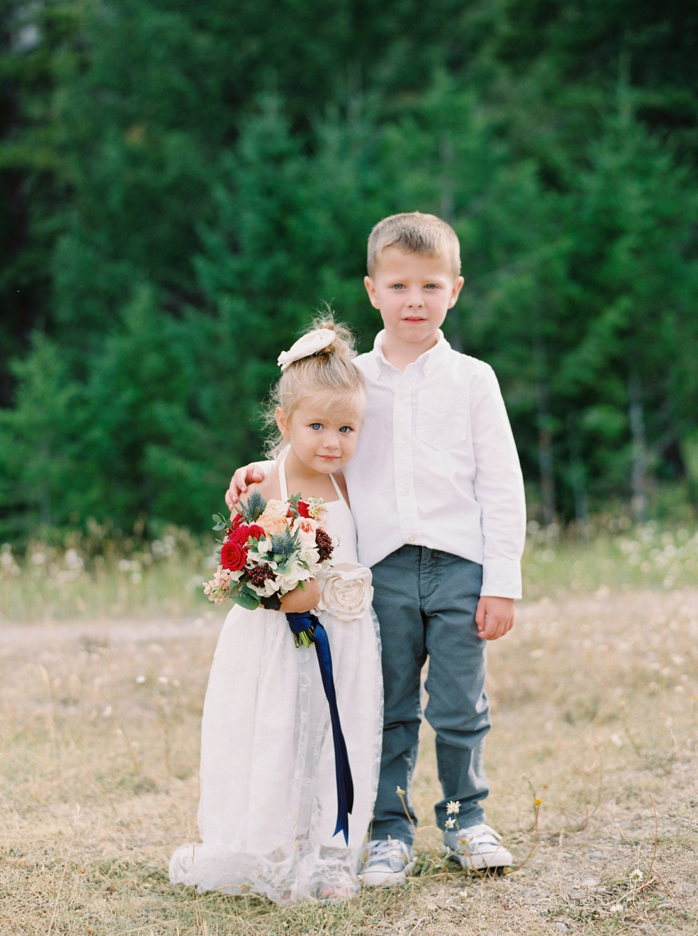 Banff Wedding Photographers | Banff tunnel mountain reservoir | wedding ceremony decor brightly colored florals | flower girl and ring bearer | Justine Milton fine art film photographers