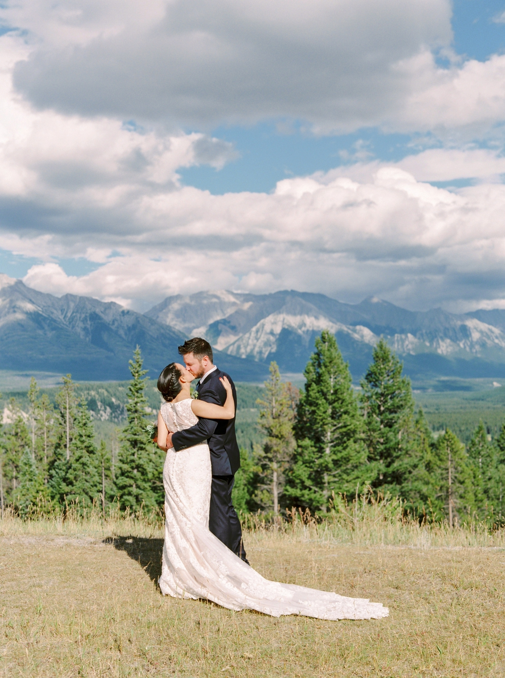 Banff Wedding Photographers | Banff tunnel mountain reservoir | bride and groom portraits | Justine Milton fine art film photographers