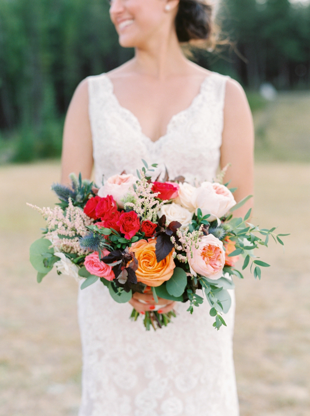 Banff Wedding Photographers | Banff tunnel mountain reservoir | brightly colored bridal bouquet | Justine Milton fine art film photographers