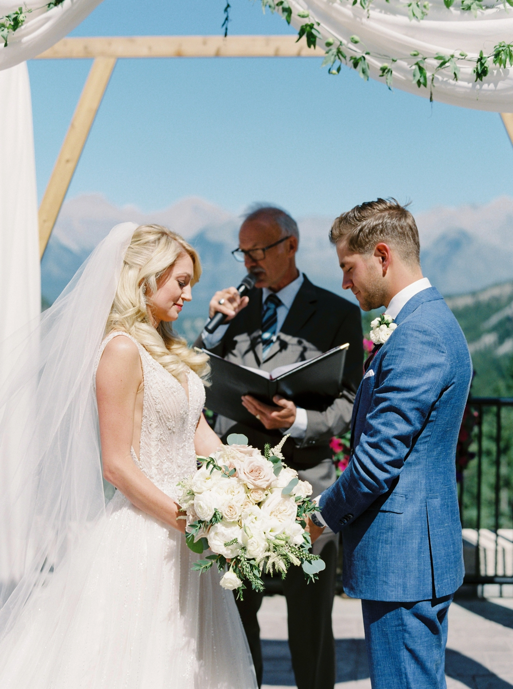 Wedding ceremony floral arch way decor at the Fairmont Banff Springs Hotel | Banff Rocky Mountain Wedding Photographers | Justine Milton fine art film photography