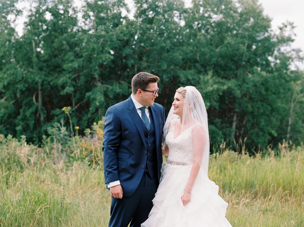 Calgary wedding photographers | The lake house wedding | First Look | Justine Milton Photography