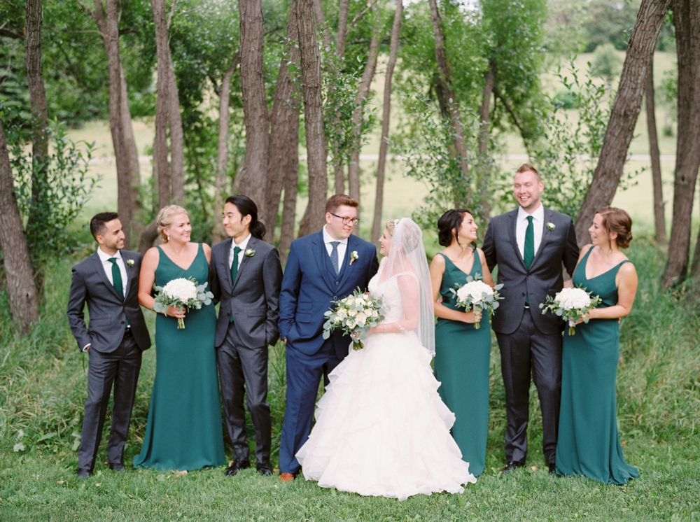 Calgary wedding photographers | The lake house wedding | Wedding Party Bridesmaids Emerald Green Dresses | Justine Milton Photography