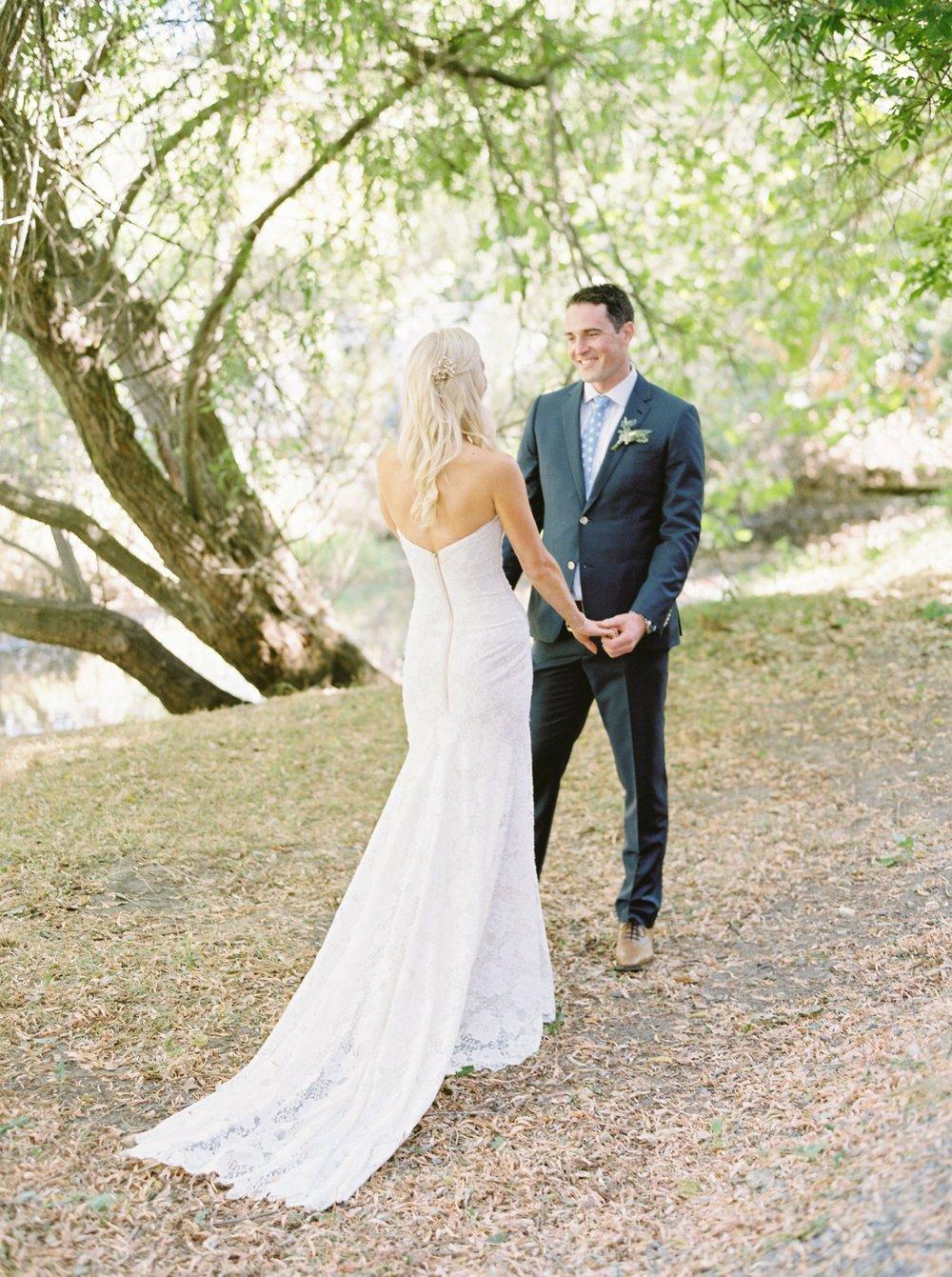 Kelowna wedding photographers | hotel eldorado wedding photographer | justine milton fine art film photography | bride and groom | bride and groom portraits | holding hands