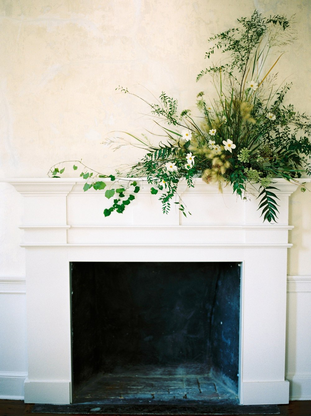 Charleston wedding photographer | anniversary session | fine art film photography | Calgary Wedding Photographers | Calgary couples photographer | Justine Milton Photography | fireplace | flowers