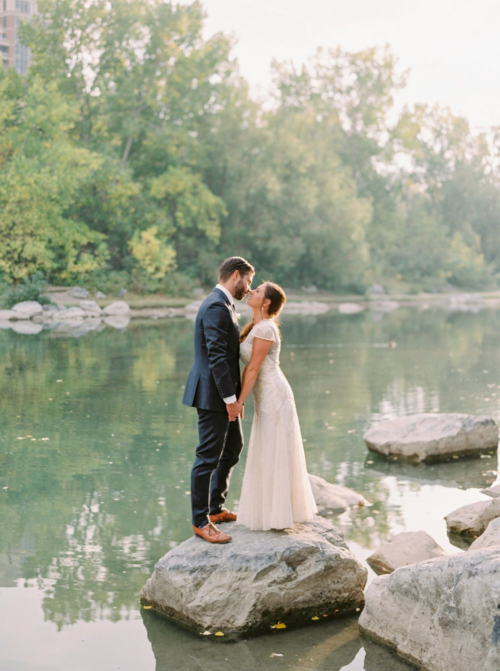 Calgary wedding photographers | fine art film | Justine Milton Photography | wedding inspiration | wedding dress | bride and groom portraits | river