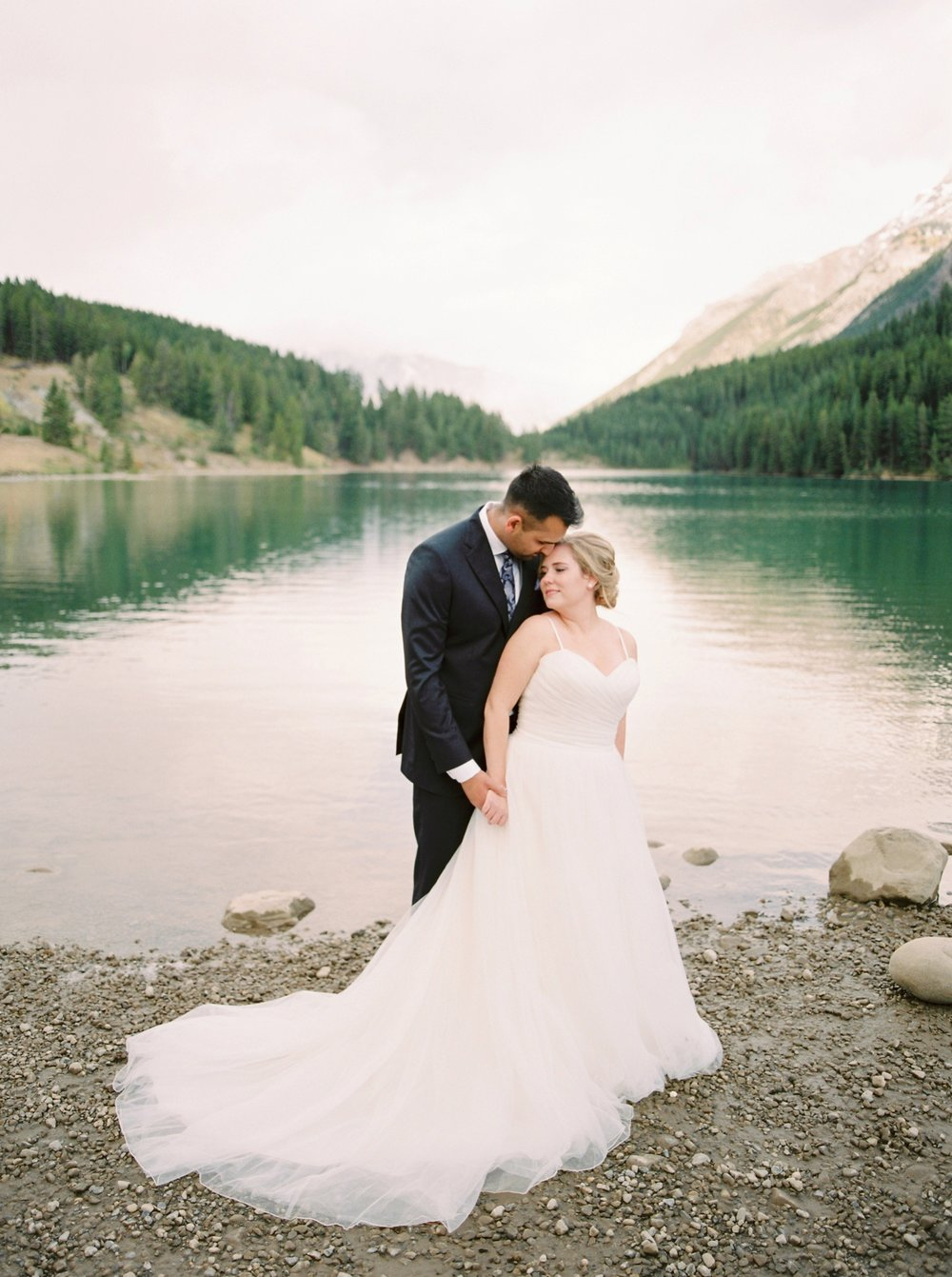 Calgary wedding photographers | banff wedding photographers | fine art film | Justine Milton Photography | wedding vows | elopement photographers | bride and groom portraits | moraine lake