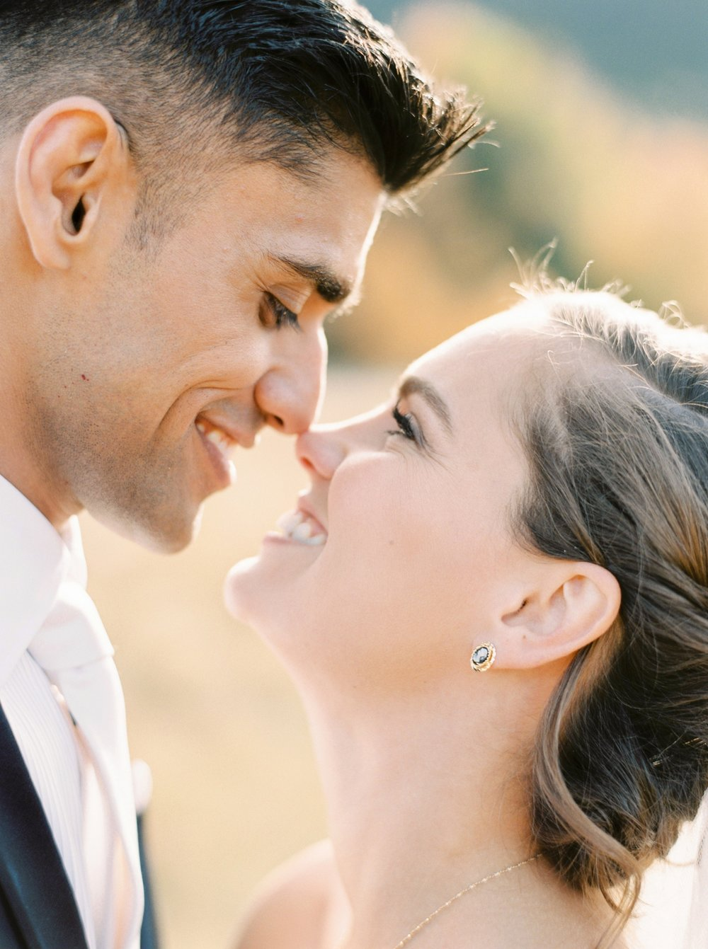Calgary wedding photographers | fine art film | Justine Milton Photography | canmore wedding photographers | bride and groom portraits | mountain photography | bride and groom kiss