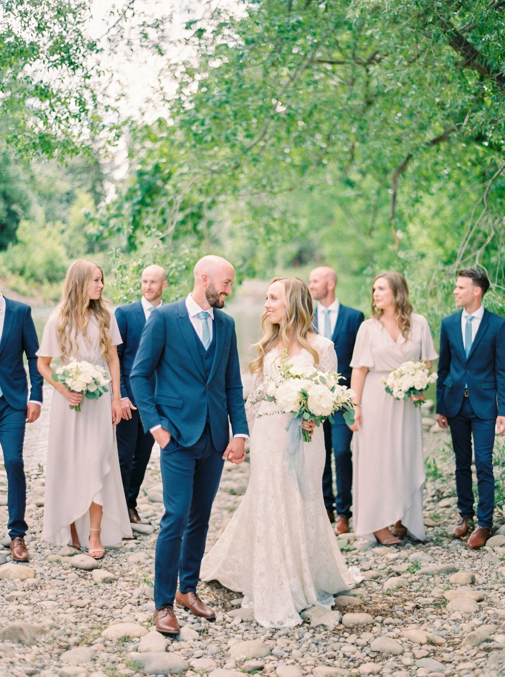 Calgary wedding photographers | The Gathered Farm Wedding | Justine milton fine art film photographer | bride and bridesmaids portraits nude dresses white peony bouquets navy blue groomsmen suits