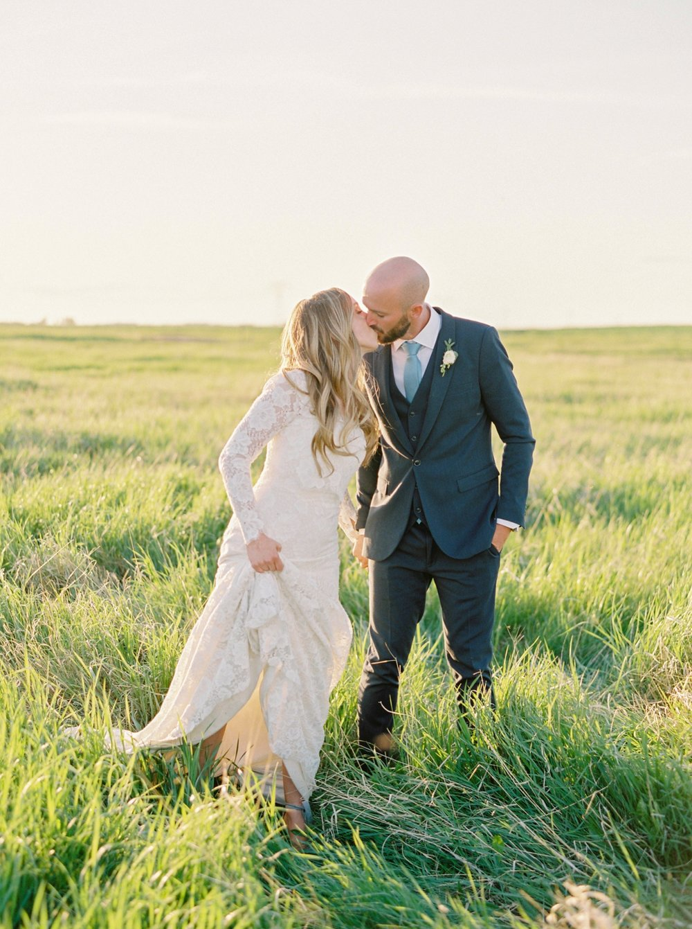 Calgary wedding photographers | The Gathered Farm Wedding | Justine milton fine art film photographer | sunset farm bride and groom portraits