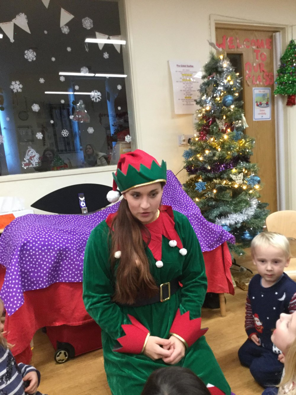 Cosmic Chloe is here to play!!! - The Preschool children enjoyed some party games and a magic show from Cosmic Chloe- they had a great time Elfing around.