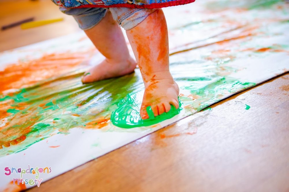 Messy Babies - Babies got really messy exploring the texture of paint using their hands and feet.