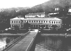 View of Immigration Station Administration Building, detention barracks and pier, c. 1916. Photo courtesy of National Archives,