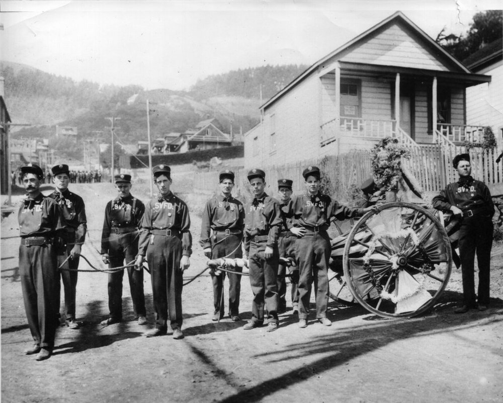 The 1909 hose cart company at Richardson and Second Streets. The young lady wreathed in flowers on the cart is the company's mascot, a niece of Fire Chief Jewett. Photo courtesy of Sausalito Historical Society