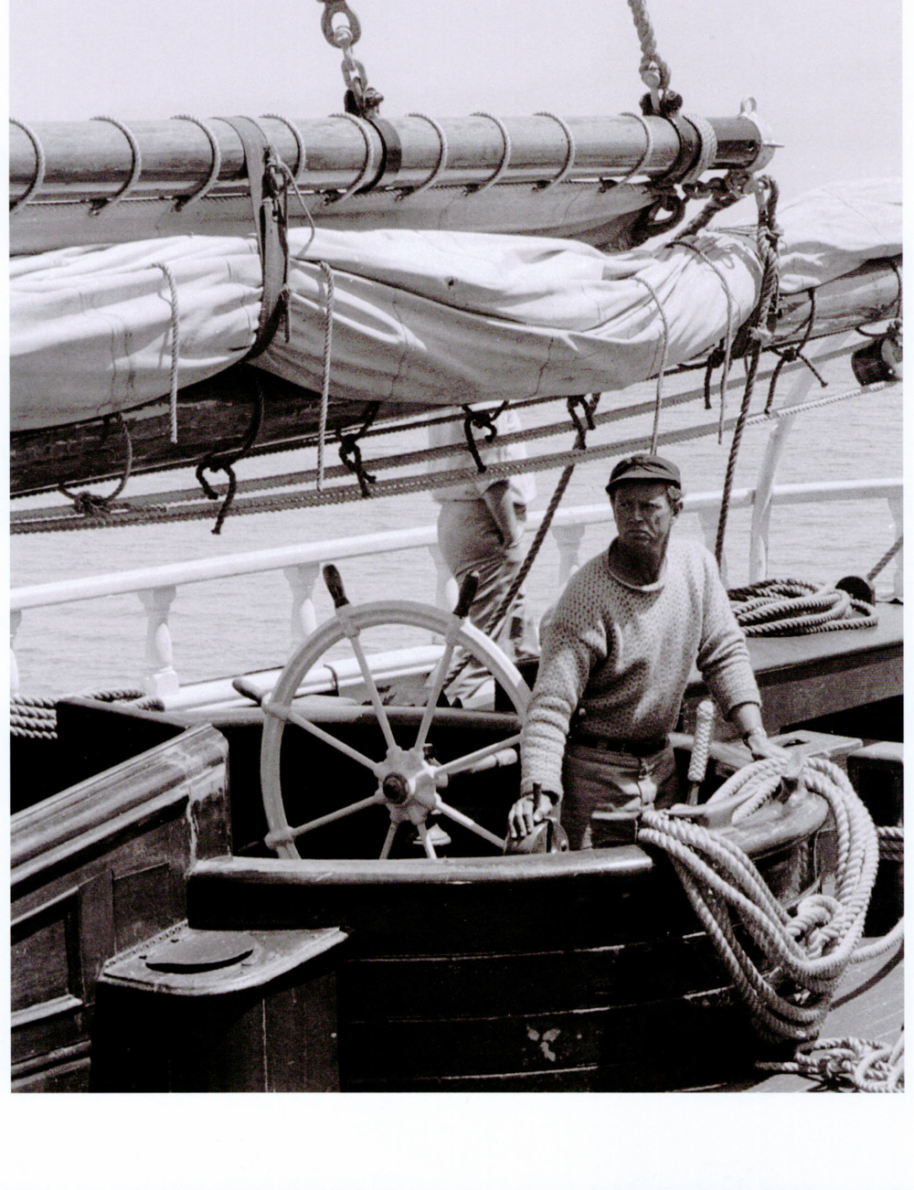 Sterling Hayden at the helm of the schooner he later renamed  Wanderer .  Photo by Craig Sharp, Courtesy of Sausalito Historical Society