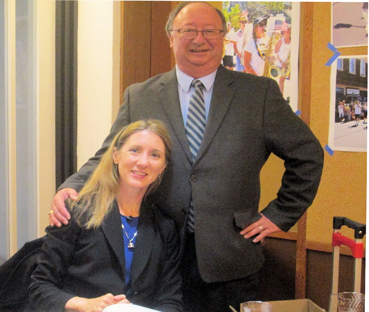 SHS President Jerry Taylor greets author Laura Ackley   atCampbell Hall.    Photo by Steefenie Wicks