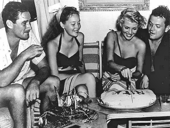 While filming, Welles and Errol Flynn (with second wife Norah Eddington,) celebrated Rita Hayworth's 28th birthday aboard the Zaca.   Photo from reelsf.com