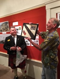 Ron Dunne, Official Historian of The Caledonian Club of San Francisco, presented Society Director Jim Muldoon with the Club's Tartan as a memento of the evening and the Club's pivotal role in the 1868 naming of Caledonia Street.