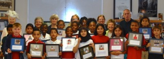 Bayside Academy third grade students proudly display their Sausalito Historical Society end- of-year awards for participation in the SHS annual, local history outreach program. Pictured with the students is long-time third grade teacher Jim Scullion and Sausalito Historical Society classroom docents.