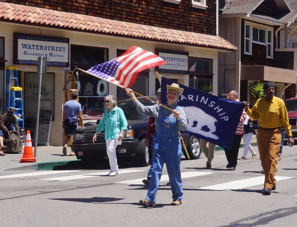 Members of the Sausalito Historical Society marching in the 2017 IDESST Festa Parade.. This year Sausalito is celebrating the 75th anniversary of the start of the Marinship shipbuilding project during World War II so the Society members were dressed in Marinship outfits and carried the Marinship banner. Photo Courtesy of Sausalito Portuguese Cultural Center