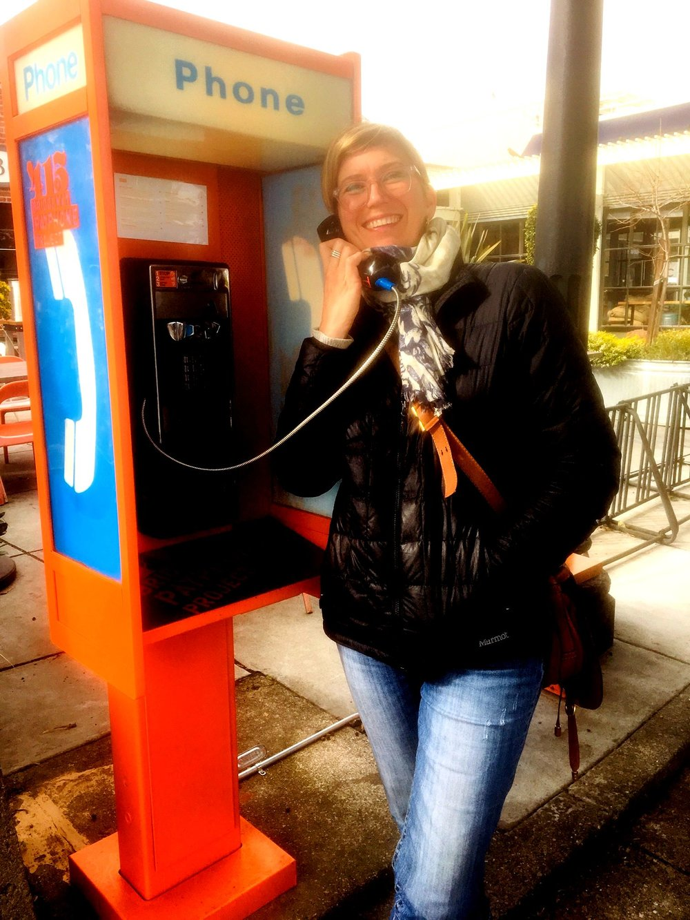 Tera Ancona checks out the payphone recordings outside Cibo.                       Photo by Larry Clinton