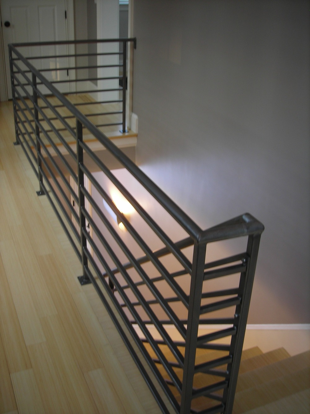 Custom Horizontal-Bar Steel Railing, with a Clear Coat Finish.