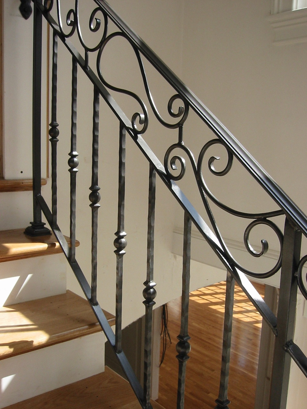 Interior Scrolled Railing with Cast Pickets. Hand-Rubbed Finish.