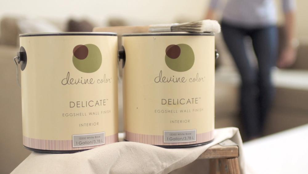 Devine Color paint cans