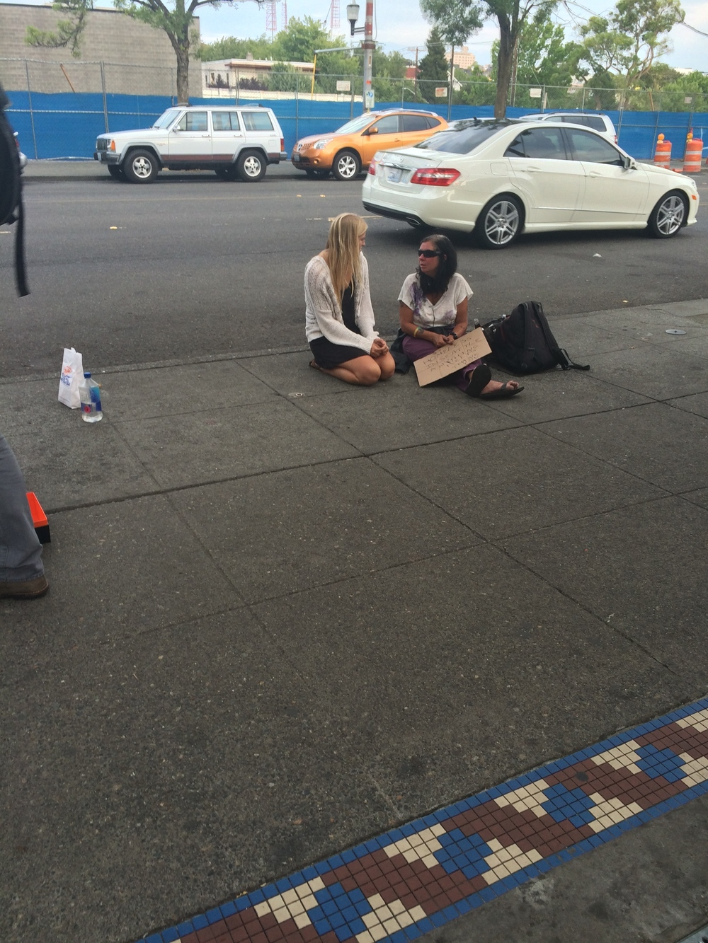 Ellie, a LBHS senior, consoles a homeless woman in downtown Seattle, WA during the Refuge high school road trip.