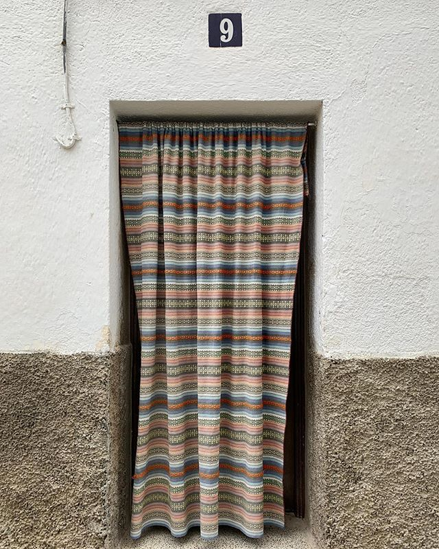 9 Travesía Guijo Coria, Cáceres. Most houses here have a fabric curtain on the door; the tradition of keeping your front door open but still keeping out flies and sunlight all year round . . . #coria #caceres #christmaseve #spain #christmas #holiday #alley #curtain #cortina #puerta #extremadura #traditions