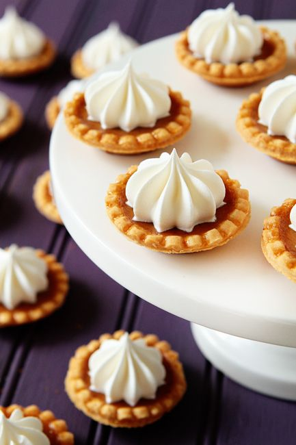 Ingredients:  48 1.75-inch  premade miniature tart shells   1/3 cup granulated sugar  1/4 teaspoon salt  1 1/2 teaspoons  homemade pumpkin pie spice   1 large egg  1 cup pure pumpkin puree  1 teaspoon pure vanilla extract  1 5-ounce can evaporated milk (this is the small can)  whipped cream or Cool Whip  Directions:  Preheat oven to 350°F. Line a baking sheet with parchment paper.  In a medium bowl with an electric hand mixer, combine sugar, salt, pumpkin pie spice, egg, pumpkin, vanilla,and evaporated milk. Beat until well combined and smooth.  Line mini tart shells on prepared baking sheet. Using a  small cookie scoop  (2 teaspoons), fill each mini tart shell with pumpkin pie filling  Carefully transfer pan to preheated oven and bake for 15-17 minutes or until shells are golden and the filling appears to be set. Carefully remove mini pumpkin pies to a cooling rack.  If desired, top with freshly whipped cream or Cool Whip.