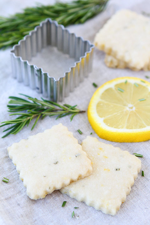Lemon Rosemary Shortbread    Yield:  About 20 cookies   Prep Time:  1 hour 10 minutes (includes chill time)   Cook Time:  10-12 minutes   Total Time:  90 minutes  Lemon Rosemary Shortbread Cookies are the perfect cookie for afternoon tea or any time! We love these crisp and buttery cookies!  ingredients:  2 cups all-purpose Gold Medal flour 1/4 teaspoon salt 1 1/2 teaspoons lemon zest 1 teaspoon minced fresh rosemary 1 cup unsalted butter, at room temperature 3/4 cup powdered sugar 1 teaspoon vanilla extract 1 teaspoon fresh lemon juice.  directions:  1. In a small bowl, whisk the flour, salt, lemon zest, and rosemary. Set aside.  2. In the bowl of a stand mixer, beat the butter and powdered sugar until smooth and creamy, about 3 minutes. Beat in the vanilla extract and lemon juice. Slowly add in the flour mixture and mix until just combined. Form the dough into a disk shape and wrap in plastic wrap. Chill the dough for at least 1 hour or until firm.   3. When ready to bake, preheat oven to 325 degrees F. Line a large baking sheet with parchment paper or a Silpat and set aside.   4. On a lightly floured surface, roll out the dough into a 1/4 inch thick square. Cut into squares, rounds, or shape of your choice using a lightly floured cookie cutter. Place shortbread cookies on the prepared baking sheet and bake for 10-12 minutes, or until cookies are very lightly browned around the edges. Remove cookies from baking sheet and cool completely on a wire rack.  Note-Shortbread cookies with keep in an airtight container for about a week or they can be frozen.