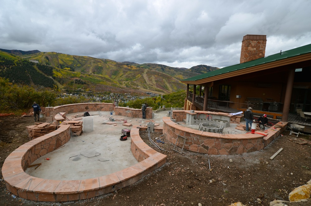 Paving and wall set out by Utah's Platinum Landscape & Pools.