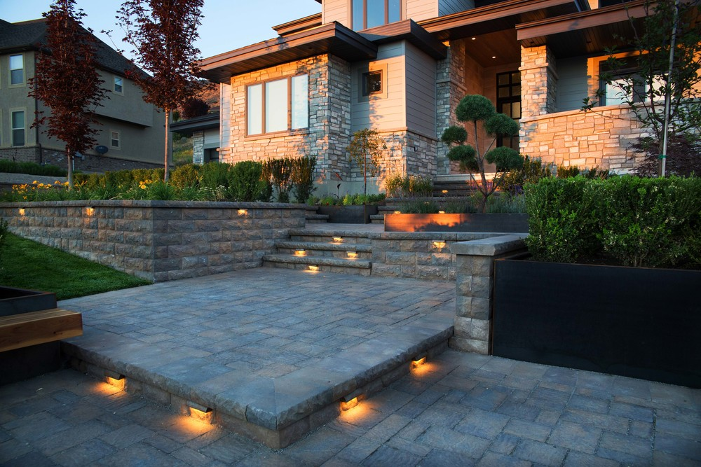 Belgard pavers and steps with lights by Platinum Landscape & Pools.