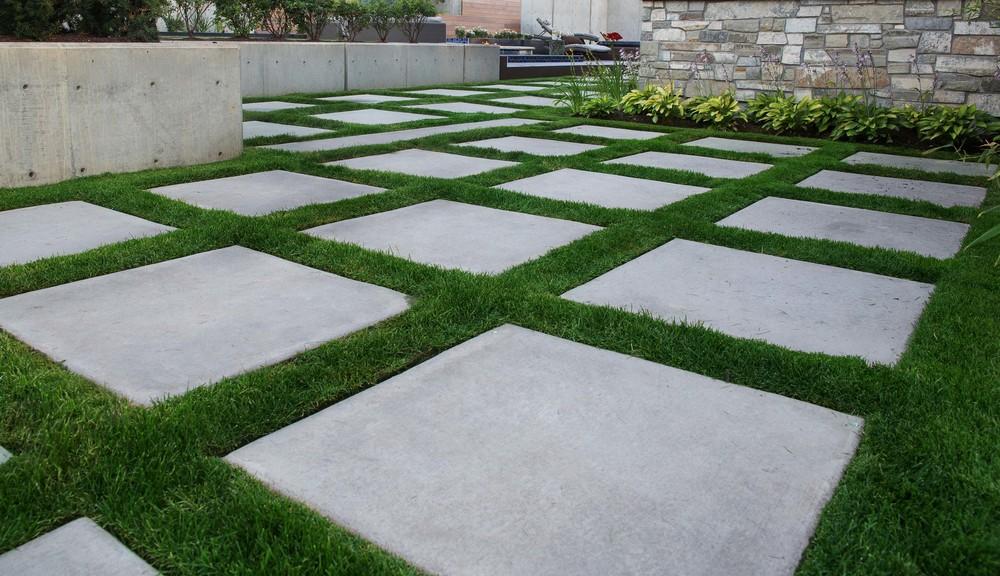 Concrete stepping stones by Platinum Landscape & Pools.