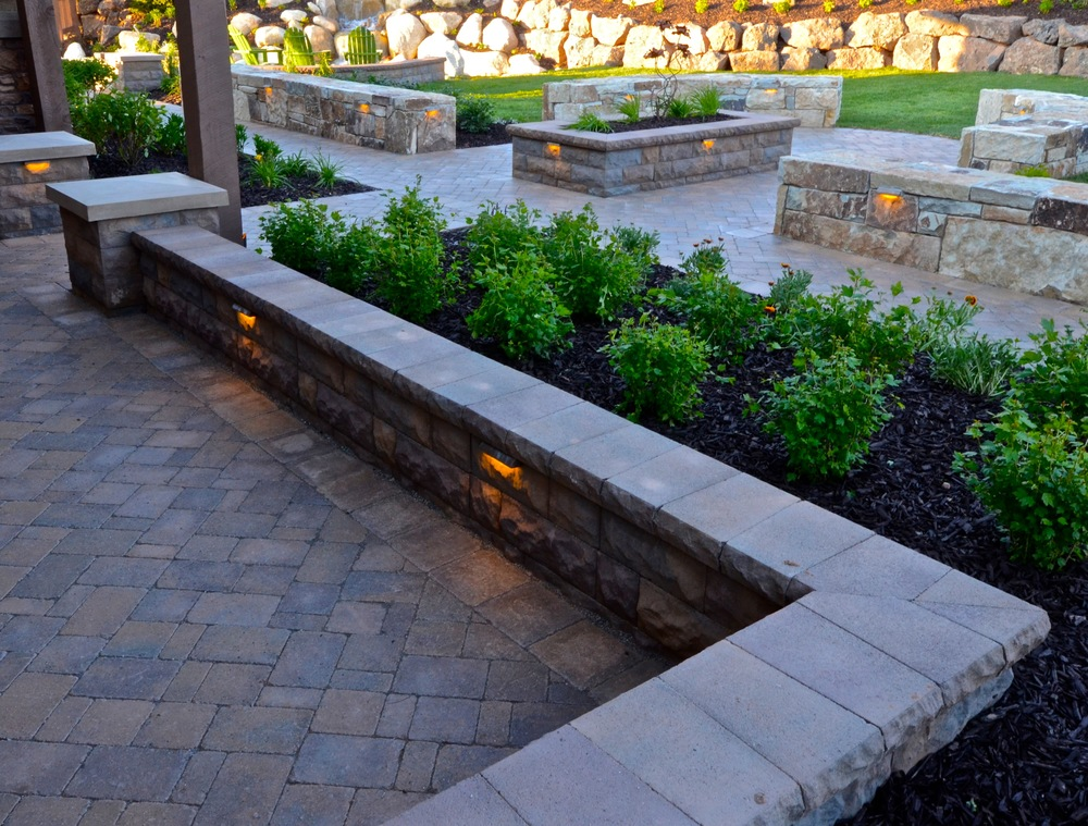 Belgard pavers and seat wall by Platinum Landscape & Pools.