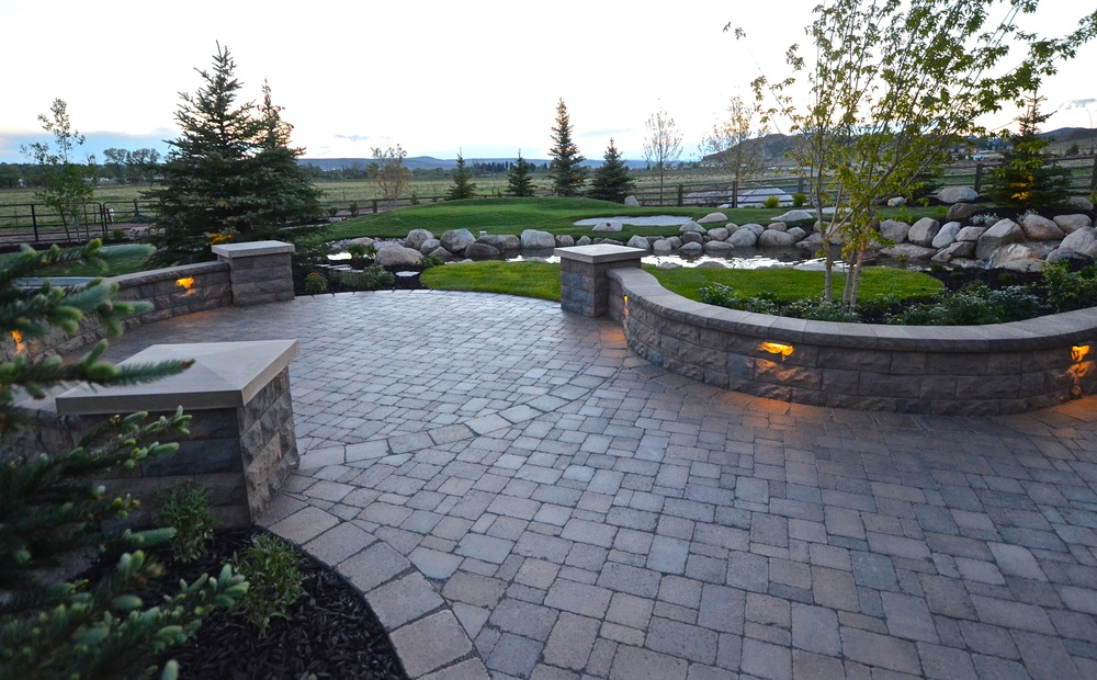 Curved Belgard seat walls and paving by Platinum Landscape & Pools.