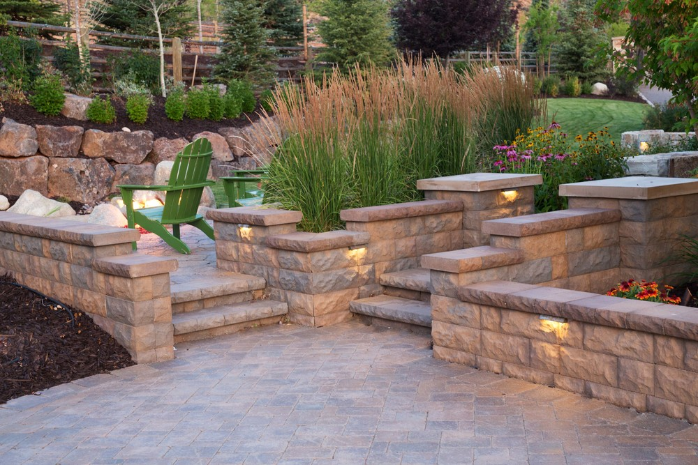 Belgard seats walls and steps by Platinum Landscape & Pools.