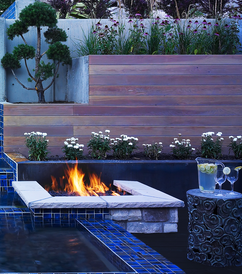 Utah fire pit and retaining wall by Platinum Landscape & Pools.