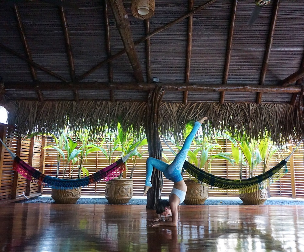 Ocean-front yoga studio at Sansara. Eco-friendly yoga pants by Inner Fire.