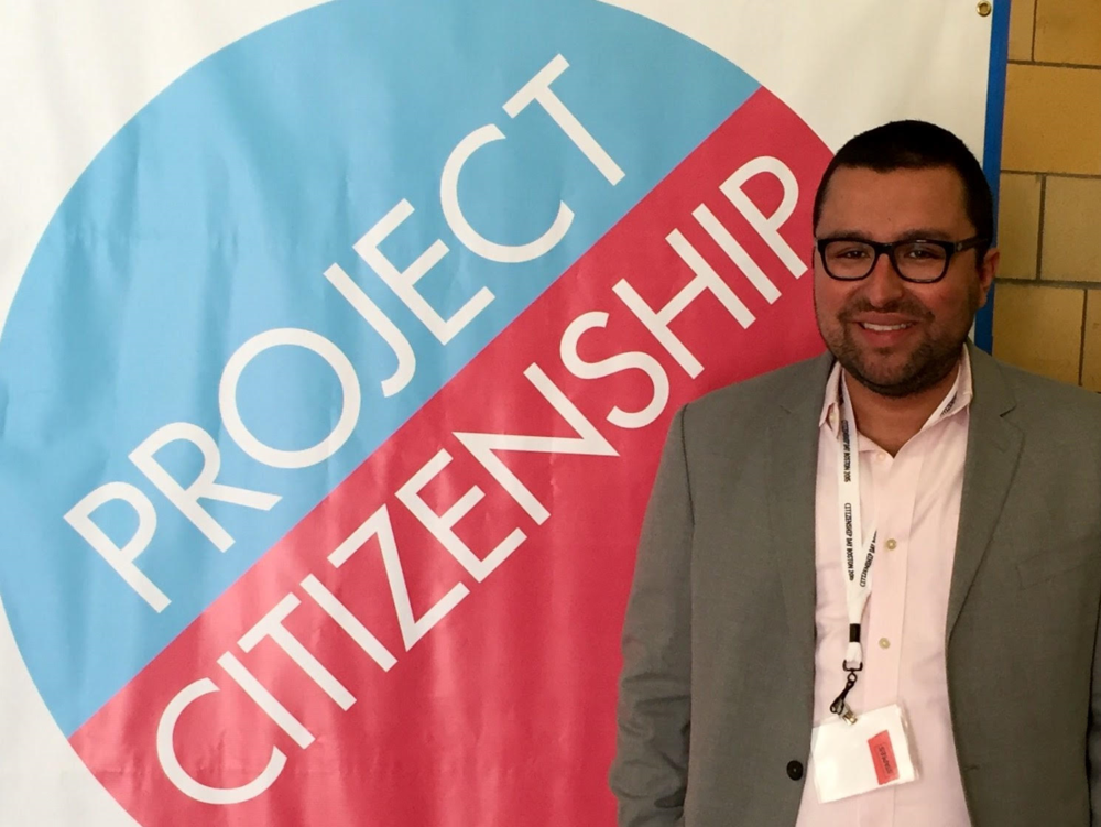 Attorney Joseph Molina Flynn attends Citizenship Day Boston in September 2015 where he assisted in completing citizenship applications free of charge. More than 200 applications were completed that day by attorneys and other volunteers in the community.