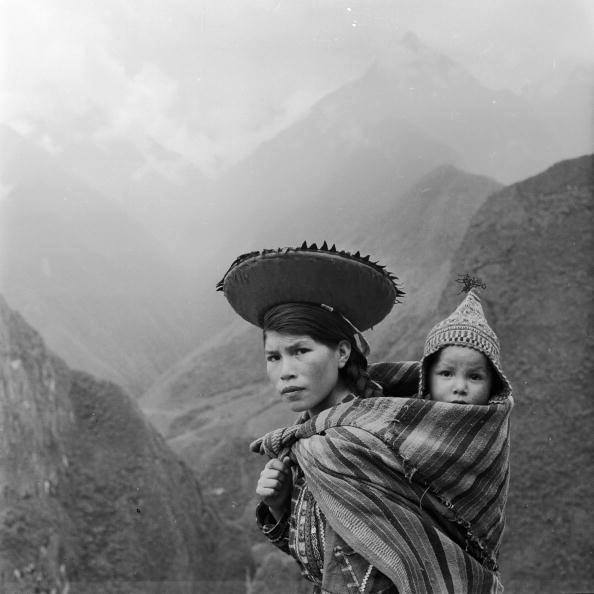 jassiepassievruchtmoodboard :   Peruvian woman in the 1950′s, carrying her child.
