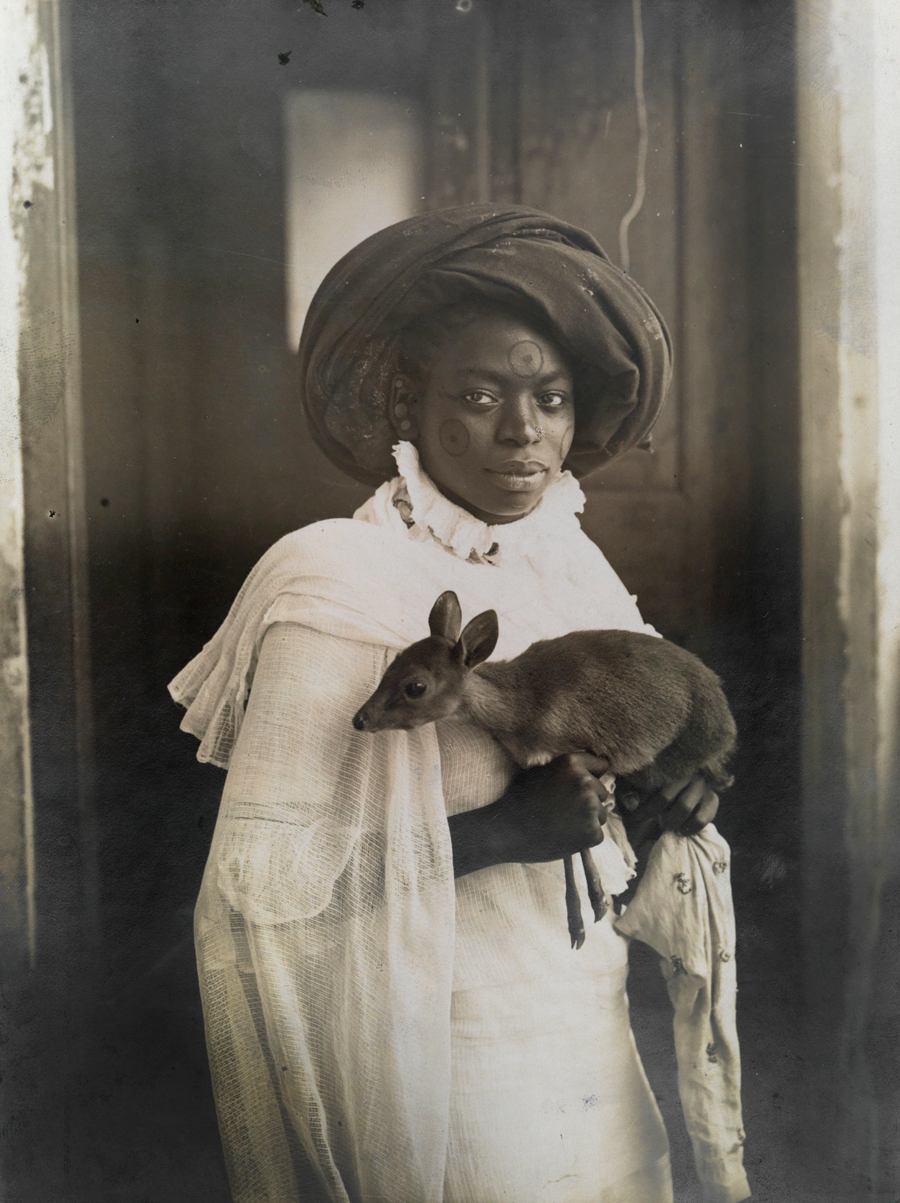 natgeofound :     A young Kenyan woman holds her pet deer in Mombassa, March 1909. Photograph by Underwood and Underwood